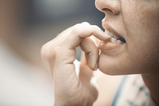 Woman in stress gnawing her nails