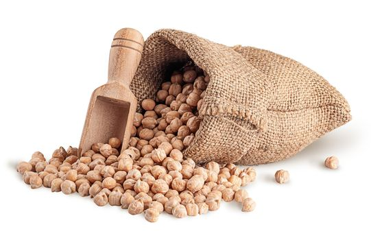 Chickpea spill out of sack and scoop