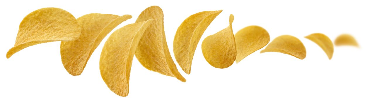 Potato chips levitate on a white background.
