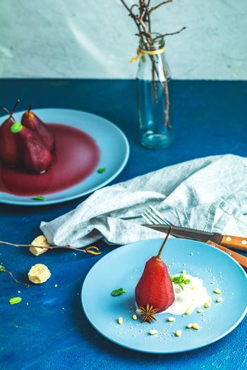 Traditional dessert pears stewed in red wine with wine sauce