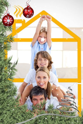 Family having fun with yellow drawing house against twinkling stars