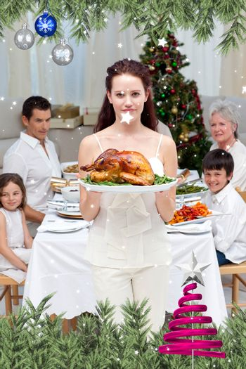 Mother showing turkey for Christmas dinner against twinkling stars