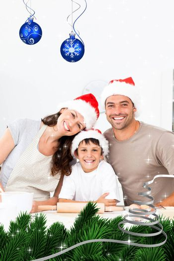 Happy family baking christmas cookies together against twinkling stars