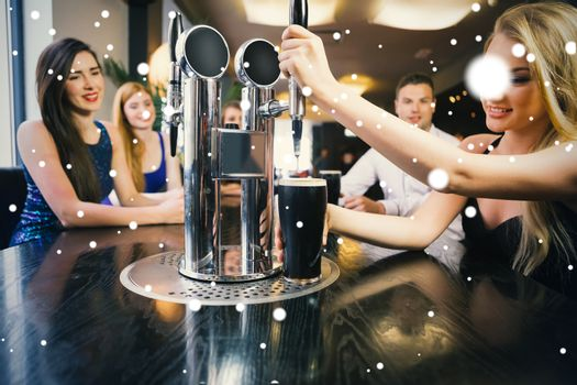 Composite image of blonde woman pulling a pint of stout