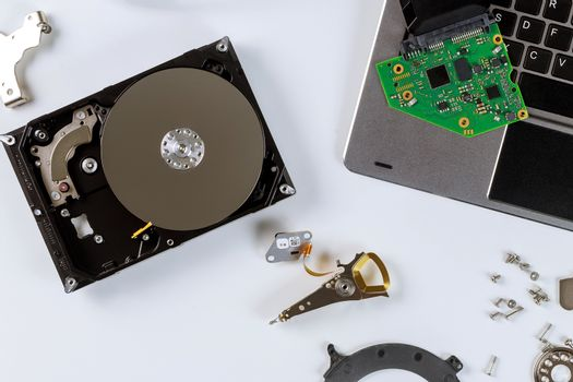 Disassembled a broken hard disk drive to repair support center