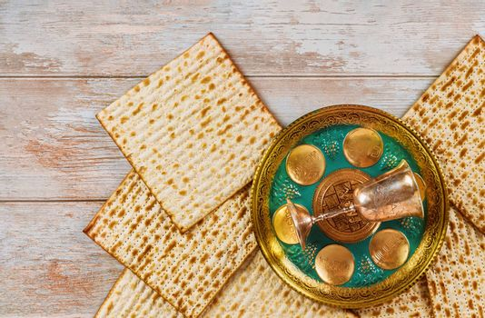 Matzoh passover jewish holiday celebration with matzoh of seder with text in hebrew egg, bone, herbs, karpas, chazeret and charoset.