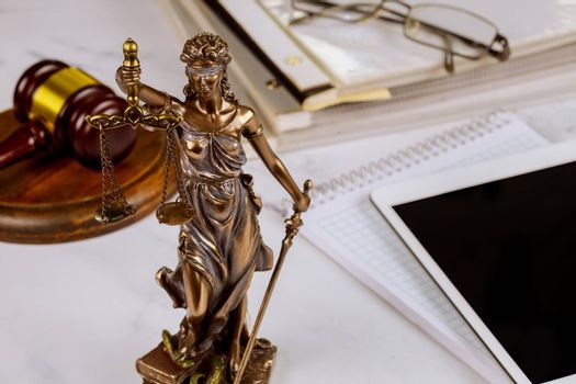 The Statue of Justice symbol, legal law office on a digital tablet of lawyers professional of Judge