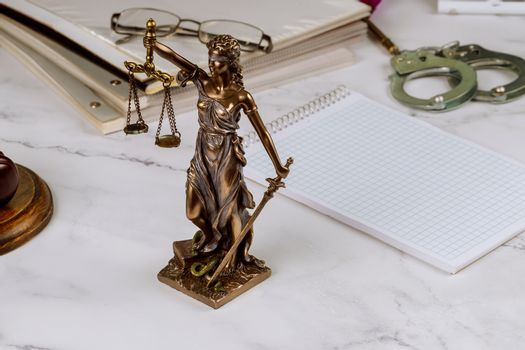 Consultation service between law justice statue in lawyer with file folder law office working document