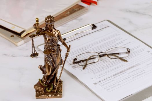 Justice statue with office workplace for lawyer legislation with gavel and document on office justice service
