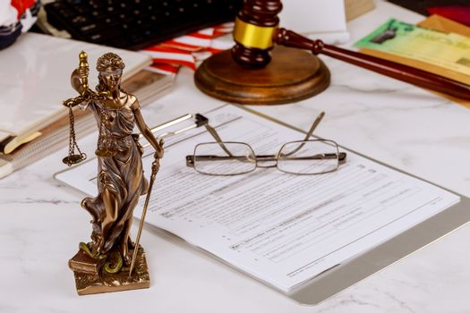 Justice statue with office consultation of lawyers professional of Judge gavel with scales of justice.