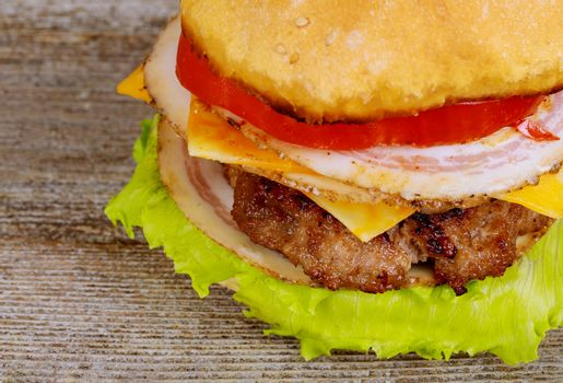 Appetizing juicy burgers with a cutlet, cheese, tomato