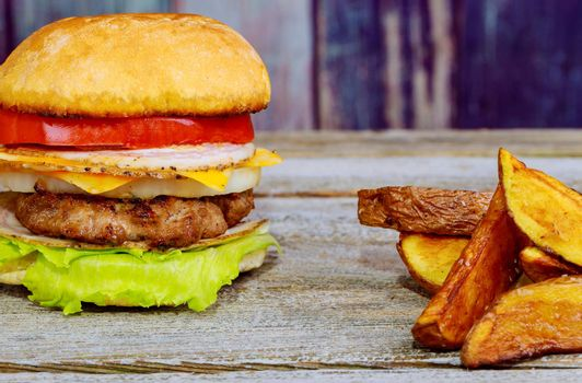 Delicious homemade double cheese burger and french fries