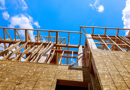 Wooden under construction new residential home beam framing