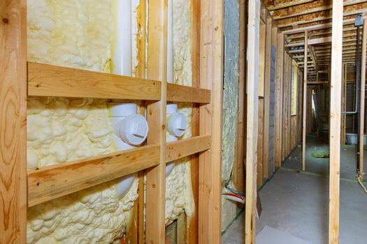 Wall of a basement thermal hydro insulation with spray foam at house construction