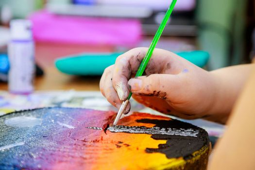 Artists paint pictures at paintbrushes a picture in wooden