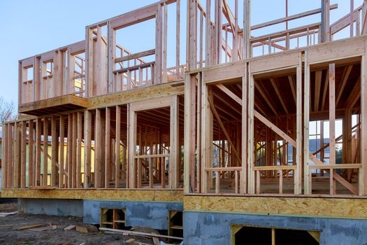 Private residential house with wooden frame under construction beams house