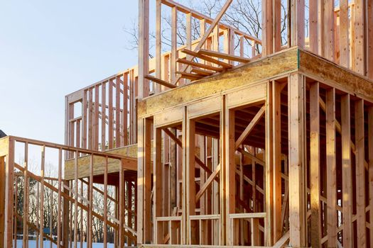 American residential beams of home in wooden frame house under construction