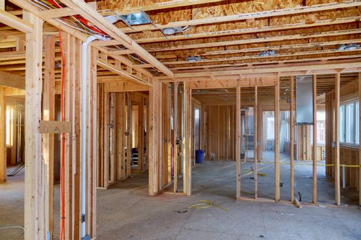 Wooden beams and wall to ceiling framed building under construction interior residential home