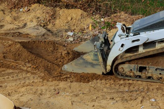 Bulldozer scoop working on the excavation works of moving earth