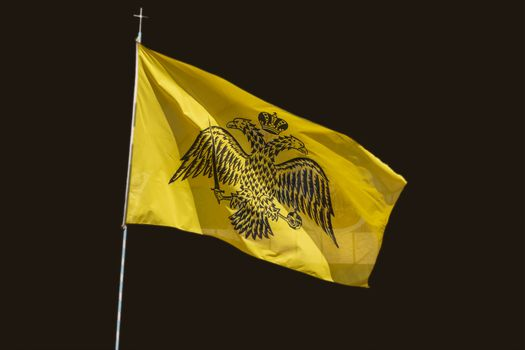 Byzantine flag isolated at black background. Greece.
