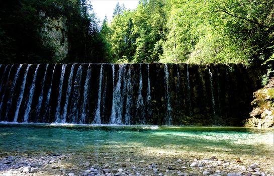 Sava waterfall in Kranjska Gora cascading down a wall