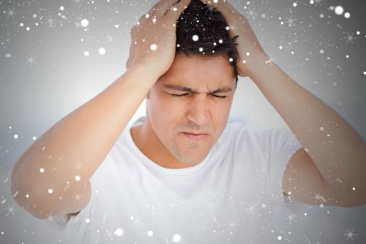 Man suffering from a migraine on waking