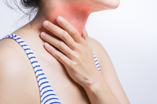 Sore throat pain women. Woman hand touching neck with sore throa