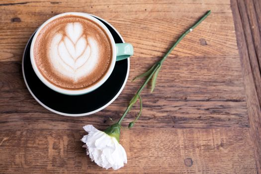 Hot mocha coffee or capuchino with heart pattern and white carna