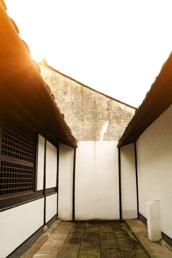 Sunbeam on roof top of Chinese house