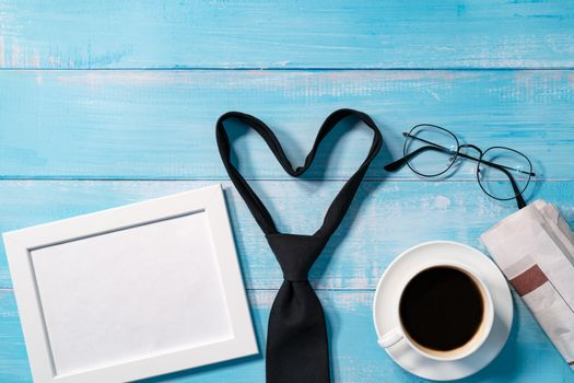 necktie with a cup of coffee and eyeglasses
