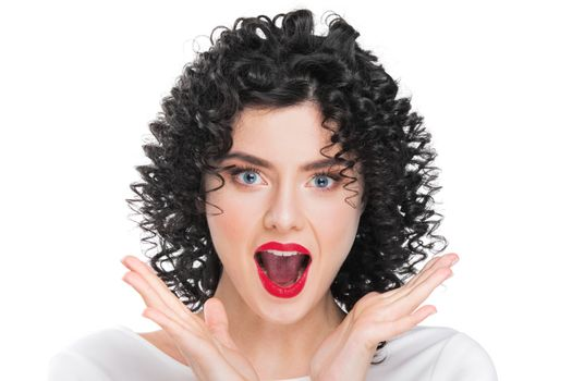Portrait of beautiful curly hair brunette girl isolated on white background. Surprised emotional face, open mouth.