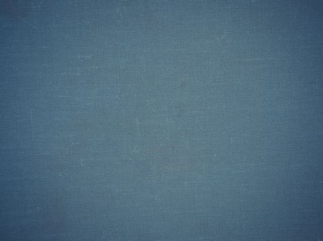 Old blue fabric cover can be used as background.