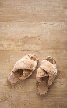 fur sandal on wooden floor