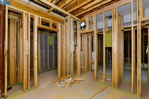 Residential home beams wall framing stick basement unfinished under construction