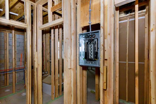 Construction home electrical power supply unfinished basement of interior wood framing