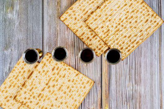 Pesah holiday celebration, matza unleavened bread and four cup kosher wine, jewish Passover holiday
