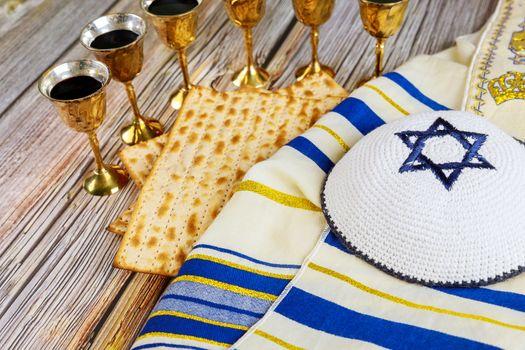 Passover holiday pesah celebration, matza unleavened bread and six cup kosher wine, jewish