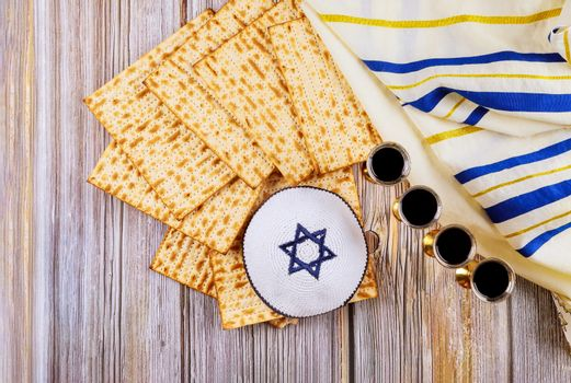 Pesach Passover symbols of great Jewish holiday matzo and wine in vintage silver glass.