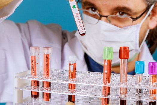 Doctor holds in his hands blood samples COVID-19 Corona Virus is world wide