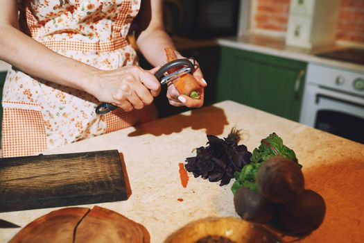 Staying at home woman preparing and cooking vegetarian food