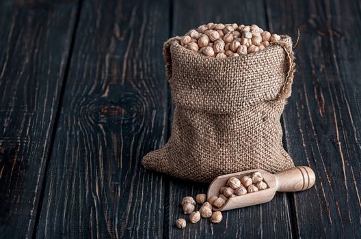 Chickpea in sack and scoop near