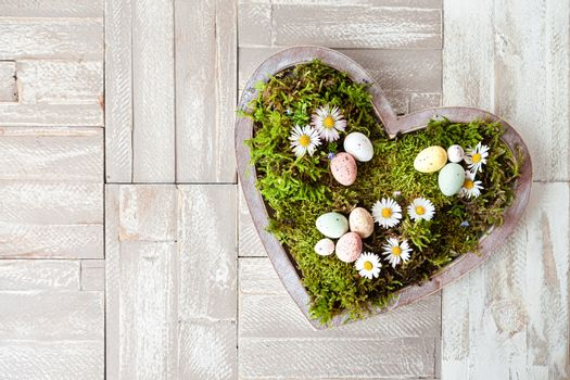 Heart with moss and flowers