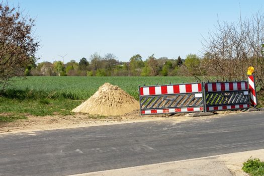 Roadworks with construction site barriers