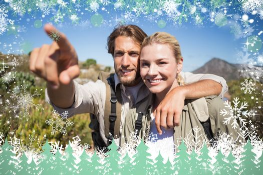 Happy hiking couple walking on mountain terrain