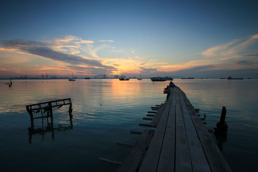 Wooden bridge at Tan Jetty, Georgetown, Penang, Southeast Asia during sunrise hour.