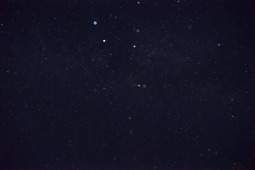 Long exposure night photo. A lot of stars with a lot of constellations. Far from the city. Night landscape with soft noise effect.