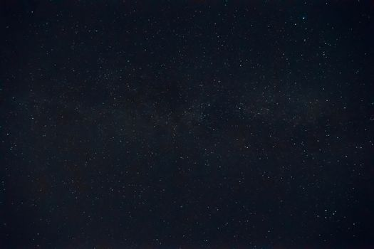 Long exposure night photo. A lot of stars with a lot of constellations. nebula in sky. Night landscape with soft noise effect.