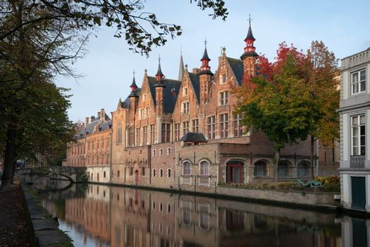 Early morning mood an the channels of Bruges with old buildings reflecting in the water, Belgium