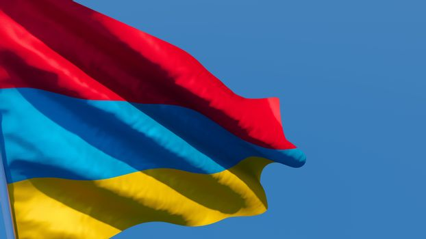 3D rendering of the national flag of Armenia waving in the wind against a blue sky.