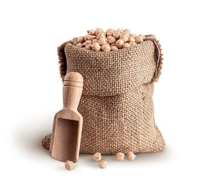 Sack with chickpeas and wooden scoop